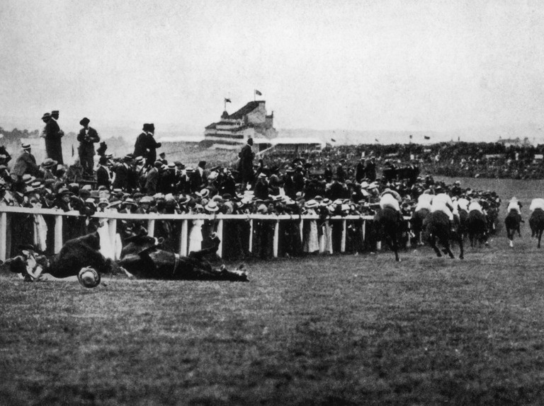 Emily Davison (1872 - 1913) is fatally injured as she tries to stop the King's horse 'Amner' at Epsom on Derby Day, to draw attention to the Women's Suffragette movement, 4th June 1913. (Photo by Arthur Barrett/Hulton Archive/Getty Images)
